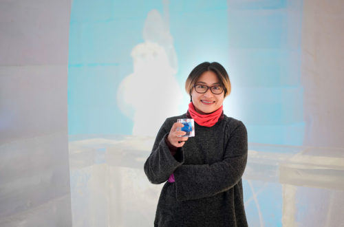 Asian woman drink cocktail in ice hotel